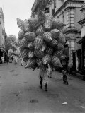Man Carrying Enormous Pile of Baskets, Bombay Photographic Print by Charles Phelps Cushing