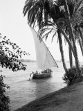 Tradition Egyptian Felucca Boat on River Nile, Cairo on Horizon Photographic Print by Charles Phelps Cushing