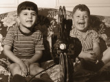 Two Boys Watching a Home Movie Using an Old Projector Photographic Print