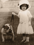 Girl in Dress and Hat, Holding Bulldog on Lead Photographic Print