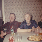 Retro Photograph of a Senior Couple Sitting at a Table Photographic Print