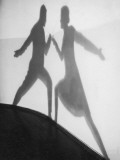 Shadow of Man and Woman Fencing Photographic Print