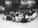 Circle of Children Reading Photographic Print