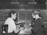 Two Female Switchboard Operators Connecting International Calls Photographic Print