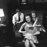 Mother and Children Reading Newspaper at Home Photographic Print