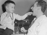 Pediatrician With Boy Holding Stethoscope Photographic Print