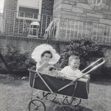Old Photograph of Two Toddlers Sitting in a Pram in the Garden Photographic Print