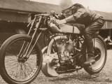 Man Sitting on Vintage Motorcycle Photographic Print