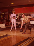 1960&#39;s Era Couple Bowling in Tenpin Bowling Alley Photographic Print by L. Willinger