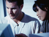 Man and Woman Looking at Computer Screen Photographic Print