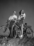 Couple Standing With Bicycles Photographic Print