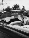 Couple in Convertible Looking at Roadmap Photographic Print