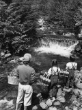 Mother and Daughters, Carrying Picnic Baskets, Looking at Waterfall Photographic Print