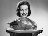 Woman Holding Platter With Roast Turkey Photographic Print