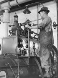 Man Oiling Machine Photographic Print