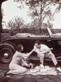 Couple Picnicking, Man Sitting on Car Runningboard Photographic Print