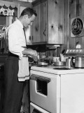 Man Cooking at Stove Photographic Print