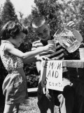 Girl and Boy at Lemonade Stand Photographic Print