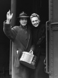 Couple Waving As They Board a Train, Circa 1930's Photographic Print