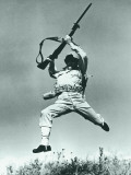 Soldier Jumping With Rifle, Low Angle View Photographic Print