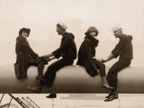 Two Sailors and Girlfriends Sitting on Ship's Cannon Photographic Print