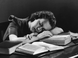 Female College Student Asleep on Open Books at Her Desk Photographic Print