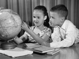 Boy and Girl Looking at Globe Photographic Print