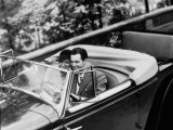 Young Couple in Vintage Soft Top Car With Golf Clubs on Back Seat Photographic Print
