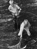 Two Boys Fishing; One Catching Fish in Net Photographic Print