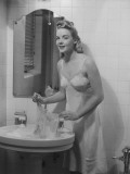 Young Woman Doing Laundry in Bathroom Sink Photographic Print by George Marks
