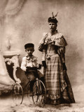 Boy (4-6) on Tricycle With Mother Photographic Print