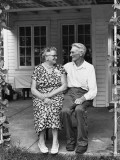 Man and Woman Sitting on Porch Photographic Print