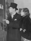 Couple in Formal Wear Showing Pass To Man at Speakeasy Door Photographie