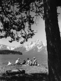Family Having Picnic By Lake; Mountains in Background Photographic Print
