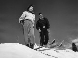 Couple Skiing, Stopped at Top of Hill Photographic Print