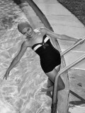 Woman in Swimming Pool Posing on Steps Photographic Print