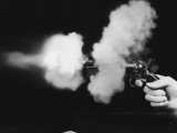 Close-Up of Gun Being Fired Photographic Print