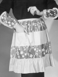 Modelling an Apron Photographic Print by Chaloner Woods