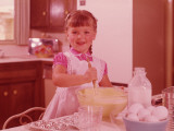 Girl Mixing Batter in a Bowl at Kitchen Table, Circa 1960&#39;s Photographic Print by L. Willinger