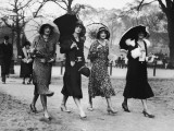Group of Women Walking With Umbrellas, Circa 1930's Photographic Print