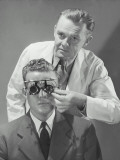 Optometrist Giving Man Eye Examination Photographic Print