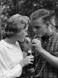 Young Couple Sharing Soda Photographic Print