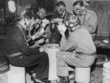 Group of Men Playing Cards, Wearing Gas Masks Photographic Print