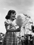 Girl Eating Cotton-Candy at Fair Photographic Print