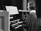 Woman Playing Organ in Church Photographic Print
