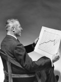 Man Looking at Chart Photographie