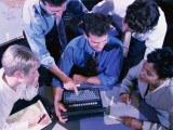 Group of People Gathered Around Laptop Computer, Overhead View Photographic Print