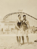 Two Men Standing on Beach Shaking Hands Photographic Print