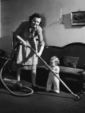 Mother and Baby Boy Holding Vacuum Cleaner Photographic Print