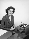 Woman Typing, Posing and Smiling Photographic Print